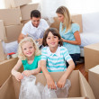Foto de Stock  : Lively family packing boxes