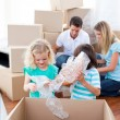 Animated family packing boxes — Stock Photo