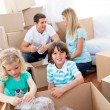 Cheerful family packing boxes — Stockfoto