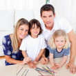 Cheerful family playing mikado in the living room — Stockfoto