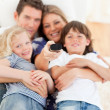 United family watching television sitting on sofa — Stock Photo