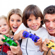 Stock Photo: Animated family playing video game