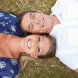 Stock Photo: Happy couple lying on the grass