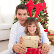 Portrait of a father and his daughter holding Christmas presents — Stock Photo