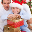 Portrait of a father and his son holding Christmas presents — Stock Photo