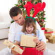 Happy father and his daughter opening Christmas gifts — Stock Photo