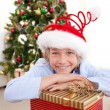 Stock Photo: Portrait of a smiling boy wearing a Christmas hat