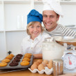 Father and son presenting their muffins — Stock Photo #10294767