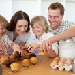 Stock Photo: Loving family eating their muffins
