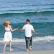Stock Photo: Loving couple walking at the seaside