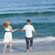 Loving couple walking at the seaside — Stock Photo