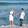 Romantic couple having fun at the seaside — Stock Photo