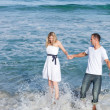Intimate couple having fun at the seaside — Stock Photo