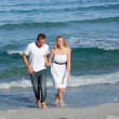 Affectionate lovers walking at seaside — Stock Photo #10294811