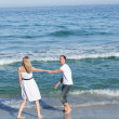 Affectionate couple walking at the seaside — Stock Photo