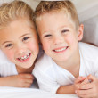 Adorable siblings playing on a bed — Stock Photo #10294850