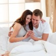 Merry couple finding out results of a pregnancy test — Stock Photo