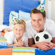 Happy child and his father playing with a soccer ball — Stock Photo #10294908