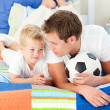 Stock Photo: Attentive father and his son playing with a soccer ball