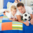 Handsome father and his son playing with a soccer ball — Stock Photo #10294916