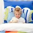 Adorable little boy lying in bed — Stock Photo