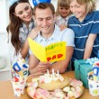Happy family celebrating father's birthday - Stock Photo