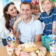 Smiling family celebrating father's birthday — Stock Photo