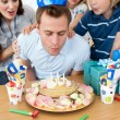 Joyful family celebrating father's birthday - Stock Photo