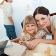 Young family decorating a room — Stock Photo