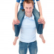 Portrait of father giving his son piggyback ride — Stock Photo #10294971