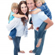 Loving family enjoying piggyback ride - Stock Photo