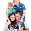 Adorable family enjoying piggyback ride — Stock Photo