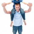 Smiling father giving his son piggyback ride — Stock Photo
