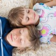 Stock Photo: Siblings sleeping on floor