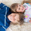 Siblings lying on the floor — Stock Photo #10295016