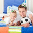 Cute little boy and his father watching football match — Stock Photo #10295025