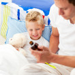 Caring man looking after his sick son — Stock Photo #10295029