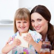 Charming mother and her daughter having breakfast — Stock Photo