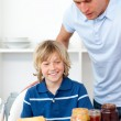 Blond little boy and his father preparing breakfast — Stock Photo