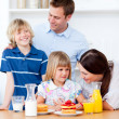 Royalty-Free Stock Photo: Jolly family eating breakfast in the kitchen
