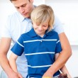 Adorable boy and his father preparing breakfast — Stock Photo