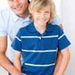 Smiling little boy and his father preparing breakfast — Stock Photo