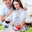 Loving couple preparing dinner — Stock Photo