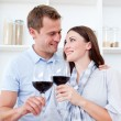Loving couple drinking red wine — Stock Photo