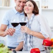 Royalty-Free Stock Photo: Smiling couple drinking wine while cooking