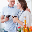 Royalty-Free Stock Photo: Romantic couple drinking wine while cooking