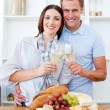 Smiling lovers drinking white wine — Stock Photo