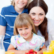 Jolly mother and her children eating waffles with strawberries — Stock Photo