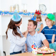 Elated man celebrating his birthday with his wife and his childr — Stock Photo