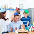Royalty-Free Stock Photo: Delighted man celebrating his birthday with his wife and his chi